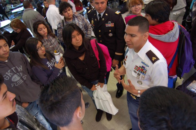 Sgt. David. Juarez, Tucson Company recruiter, tells his Army story to Sunnyside High School students during a leadership seminar in December 2012.