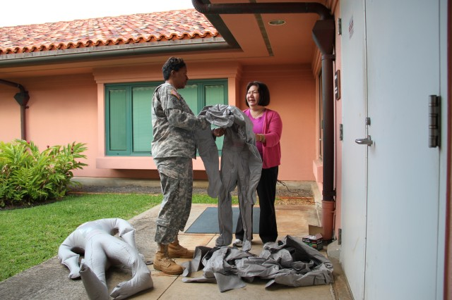 HONOLULU -- Col. Tanya Baker (left), coordinator, Federal Coordinating Center, Tripler Army Medical Center, and Melva Mun, assistant nurse manager, Veterans Affairs Pacific Islands Health Care System Center for Aging, work together to prepare inflatable mannequins of a mass casualty exercise, Feb. 5, here. The mannequins served as the three casualties who died during the exercise, which included an explosion in the Center for Aging's kitchen.