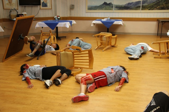 HONOLULU -- Nursing students from the University of Hawaii-Manoa played casualties during a mass casualty exercise held at the Center for Aging, Feb. 5. The exercise included an explosion in the center's kitchen and involved treating casualties on site and then evacuating them to Tripler Army Medical Center's emergency room.