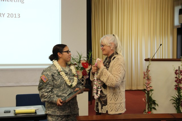 "HONOLULU "" Dr. Sarah Marshall (right), University of Hawaii, gets ready to present Maj. Veronica Almeida, Department of Social Work, Tripler Army Medical Center, with a lei after she was awarded the Army Social Worker of the Year designation.  Marshall is a former professor of Almeida's when she was a student at UH in 2008.  Read more about Almeida and the Social Worker of the Year award at www.army.mil/article/94148/."
