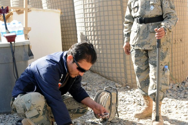 Afghan Border Police explosive ordnance disposal technicians 1st Lt. Azim Noori and 2nd Sgt. Abdul Khan, discuss methods of responding to an improvised explosive devise during a joint training session with U.S. Air Force EOD personnel, Feb. 6, 2013, at Forward Operating Base Spin Boldak, Afghanistan. The training allowed International Security Assistance Force personnel to validate the ABP EOD certifications.