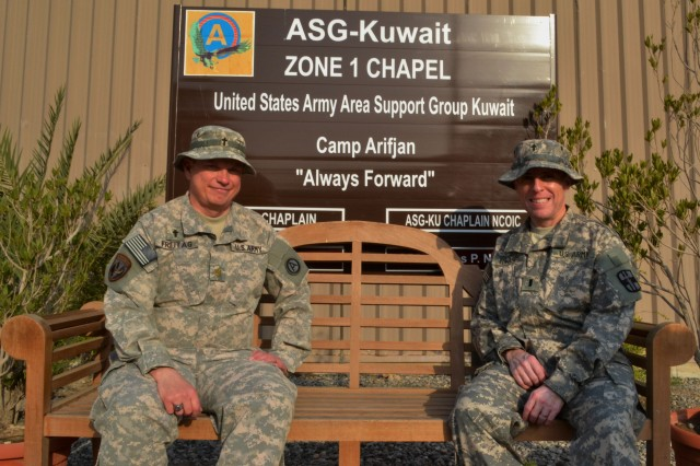 CAMP ARIFJAN, Kuwait--From left, Maj. James A. Freitag, a reserve component chaplain assigned to the 122nd Chaplain's Detachment, Seagoville, Texas, deployed as the operations chaplain for Area Support Group Kuwait and 1st Lt. Cecil D. Edwards, also a reserve component chaplain for the 349th Combat Support Hospital, (FWD), Bell, Calif., deployed as the chaplain for the U.S. Army Hospital, Kuwait, pose for a photo in front of the Zone 1 Chapel at Camp Arifjan, Kuwait Feb. 8. These officers are the first former sergeants major who have become chaplains in the history of the Army. (Army photo by Sgt. 1st Class Teresa L. Adams, 28th Public Affairs Detachment)