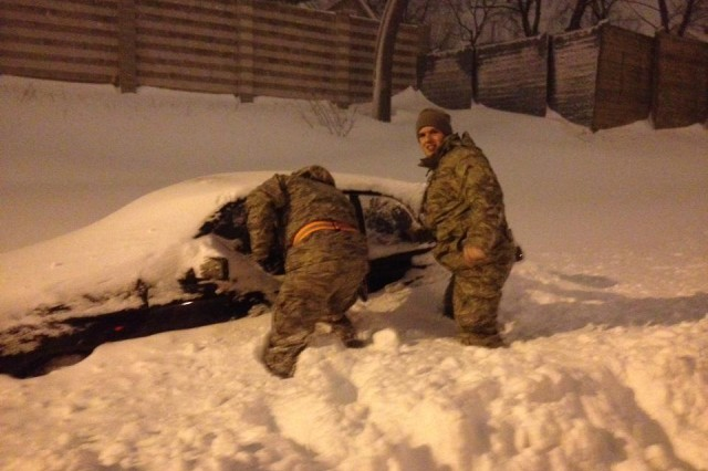 Members of the Connecticut Air National Guard, 103rd Air Control Squadron, assist stranded motorists in New Haven, Conn., in the midst of a major winter storm that hit New England.