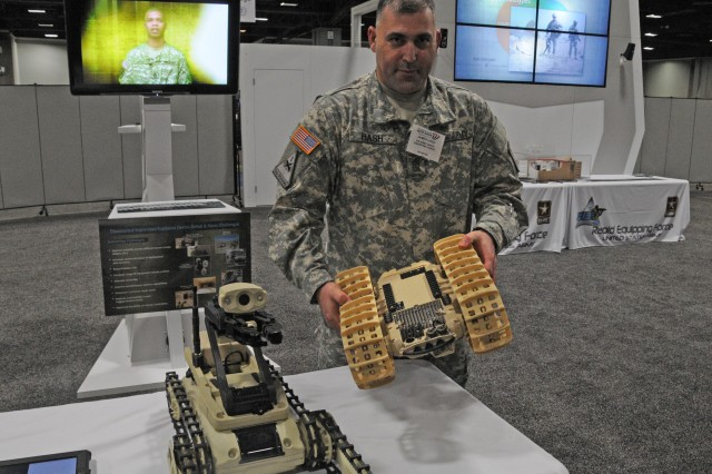 Sgt. Maj. James Hash shows a Rapid Equipping Force procured Dragon Runner, operated by Soldiers remotely in Afghanistan for reconnaissance and  counter improvised explosive device operations. The venue is the Washington Auto Show in February 2013, in the nation's capital.