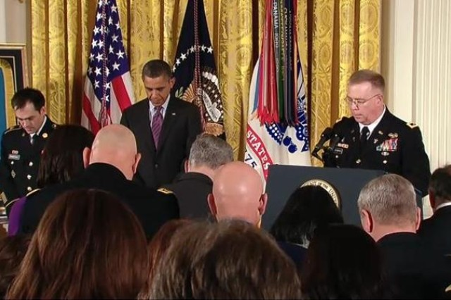 Chaplain (Major General) Donald Rutherford prays at Clinton Romesha's Medal of Honor ceremony