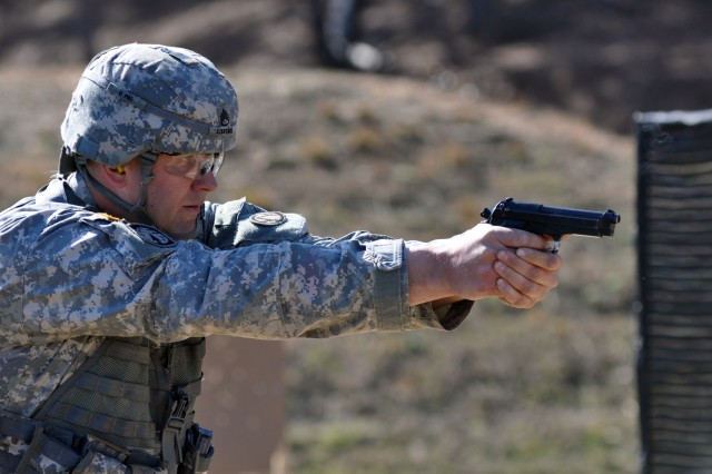 Army Reservist Staff Sgt. Robert Szkutnik fires during a combined arms stage Feb. 6, 2013, during the 2013 U.S. Army Small Arms Championships. Soldiers from the entire force participated in the two-week marksmanship training event at Fort Benning, Ga., competing against their peers and receiving invaluable marksmanship training in pistol, rifle and combined arms matches.