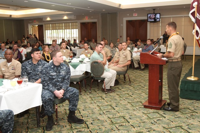 "HONOLULU "" United States Marine Corps Gunnery Sgt. Patrick Tyrrell delivers remarks to more than 140 military commands, blood drive coordinators and donors during Tripler's annual Blood Donor Center appreciation ceremony, Jan. 25, at the Enlisted Club at Joint Base Pearl Harbor-Hickam, here. Tyrrell's daughter, Haley, was diagnosed with medulloblastoma""a brain and spinal cord cancer. He spoke about Haley's surgeries, treatments and how grateful he and his family are for everyone who donates at the ceremony."