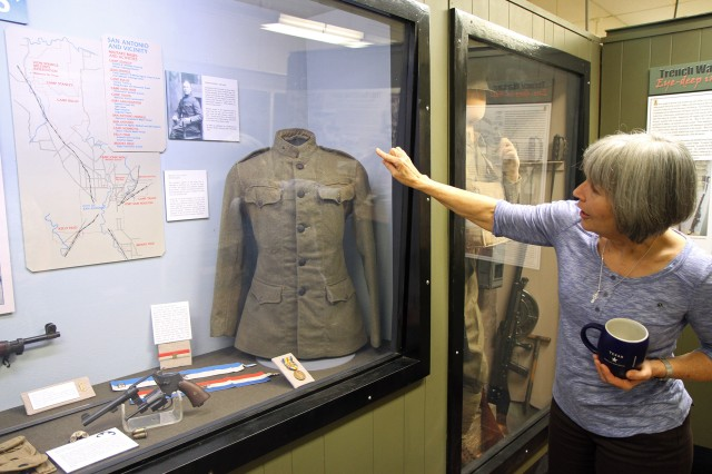 "FORT SAM HOUSTON, Texas "" Jacqueline Davis, director of the Fort Sam Houston Museum, points to a World War I era field uniform as she explains how field uniforms evolved into the Army Combat Uniform. The museum is moving to the Army North Quadrangle in September and will reopen at its new location in early 2014."