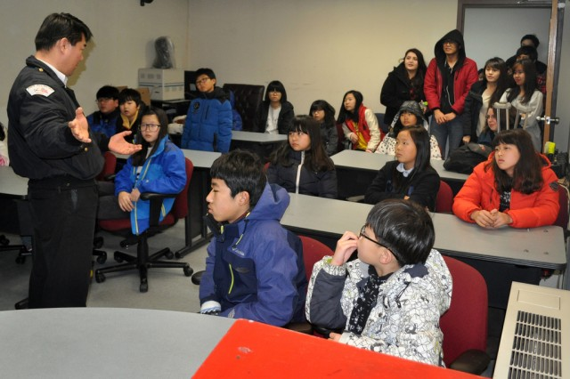 Camp participants of with the Keukdong University Global Leadership Development Program, listen to a lecture given by Yongsan's firefighter during an on-site field trip here, Feb. 1. (U.S. Army photo by Pfc. Jung Jihoon)