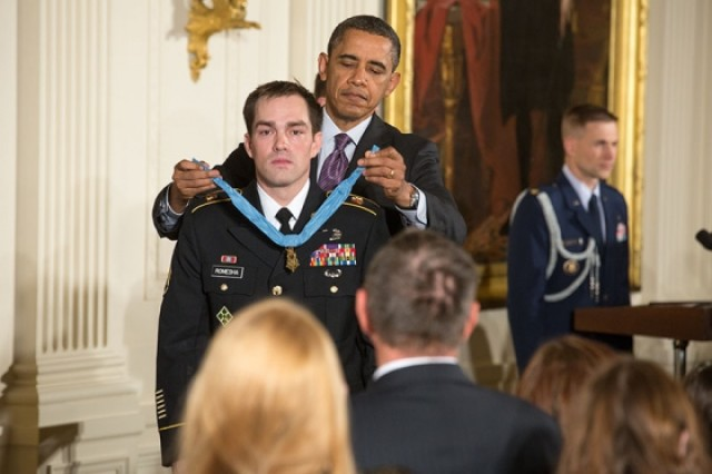President Barack Obama awards former Staff Sergeant Clinton Romesha the Medal of Honor for conspicuous gallantry, during a ceremony in the East Room of the White House, Feb. 11, 2013.