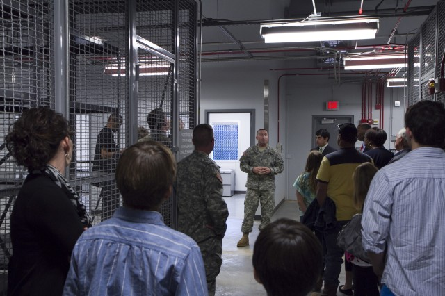 Sgt. 1st Class John Booker of the 228th Truck Company gives guests a tour of the new Statham Army Reserve Center in Statham, Ga. just after the ribbon cutting ceremony on February 9. The new facility will be home to the 228th Truck Company, 514th Trailer Transfer Detachment, 525th Trailer Transfer Detachment and the 939th Cargo Transfer Company.
