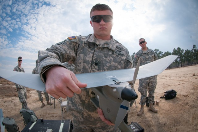 An unmanned aerial vehicle operator with the 82nd Airborne Division's 1st Brigade Combat Team, assembles a Raven during a UAV refresher course, Feb. 5, 2013, at Fort Bragg, N.C.  The Raven is slightly smaller than the UAVs that infantry units commonly operate in Afghanistan, but the skills to fly them both are the same.