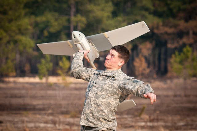 Spc. Corey Deer, an unmanned aerial vehicle operator with 1st Battalion, 504th Parachute Infantry Regiment, launches a Raven during a UAV refresher course, Feb. 5, 2013, at Fort Bragg, N.C.  His battalion is part of the 82nd Airborne Division's 1st Brigade Combat Team.