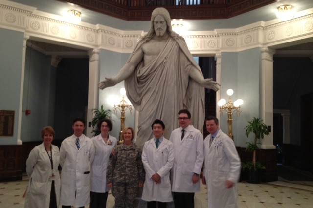 "(Left to right) Cindy Cohen, DNP, CRNP; Damon Cooney, MD, PhD; Carisa Cooney, MPH, CCRP; Lt. Gen. Patricia Horoho, Army Surgeon General; Andrew Lee, MD; Gerald Brandacher, MD; Jaimie Shores, MD stand in front of the ""The Devine Healer"" statue in Billings Hall, Feb. 11, 2013, at the Johns Hopkins University Hospital in Baltimore."