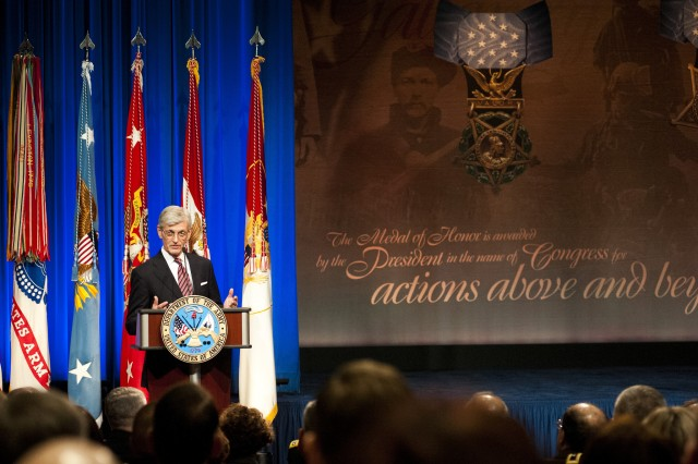 Secretary of the Army John M. McHugh spoke during a ceremony, Feb. 12, 2013, at the Pentagon.  During the ceremony, Medal of Honor recipient former Staff Sgt. Clinton Romesha was inducted into the Pentagon Hall of Heroes.