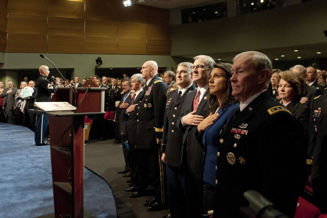 Military senior leaders listen to the national anthem during a ceremony, Feb. 12, 2013, at the Pentagon.  During the ceremony, Medal of Honor recipient former Staff Sgt. Clinton Romesha was inducted into the Pentagon Hall of Heroes.