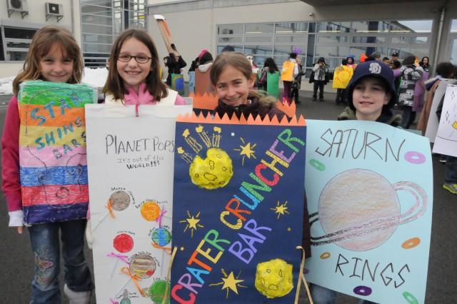 Kierra Holden, Sydney Bisha, Liliana Palmer and Cameron West show off their candy creations Netzaberg Elementary School's Fasching parade, Feb. 8.
