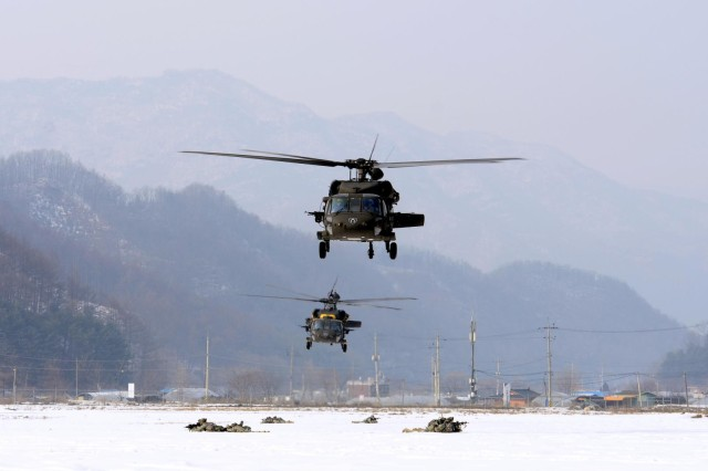 A UH-60 Black Hawk helicopter drops U.S. Soldiers with Company A, 2nd Battalion, 9th Infantry Regiment, 1st Armored Brigade Combat Team, into a drop zone during an air assault mission near Rodriguez Live Fire Range, Dongducheon, South Korea, Jan. 31, 2013. (U.S. Army photo by Sgt. Juan F. Jimenez/Released)