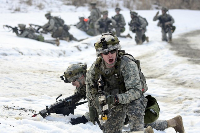 A U.S. Army Soldier with Company A, 2nd Battalion, 9th Infantry Regiment, 1st Armored Brigade Combat Team, shouts commands to his team during an air assault mission near Rodriguez Live Fire Range, Dongducheon, South Korea, Jan. 31, 2013. (U.S. Army photo by Staff Sgt. Kyle Richardson/Released)