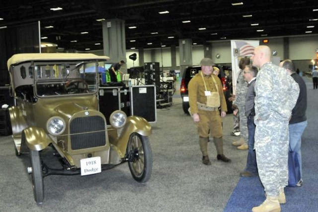 Mark Ounan of Fairfield, Pa., (in the World War I era Army uniform) chats with a number of Washington D.C., Auto Show spectators about his 1918 Dodge town car.