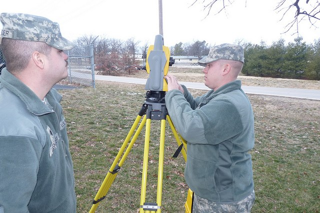 Missouri National Guard Spc. Brian Miller (left), and Spc. Derek Lenger, both members of Headquarters and Headquarters Company, 35th Engineer Brigade, test a surveying transit before they travel to Guantanamo Bay, Cuba, for their annual training.