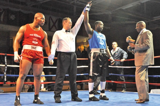 Wiesbaden's Rubin Stackhouse is declared the winner after the referee stopped his super heavyweight match-up against the Bavarian military community's Gabriels Nichols.