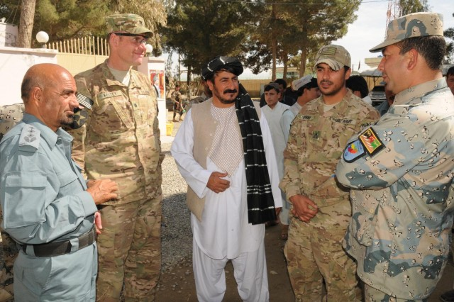 Lt. Col. Thomas M. Feltey, commander of 2nd Battalion, 23rd Infantry Regiment, meets with Spin Boldak, Afghanistan, district leaders shortly after a shura at the district center, Feb. 11, 2013. The meeting brought together district leaders to discuss future cooperation.