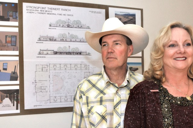 United States Army Reserve Soldier Col. Frank Kestler (left), and his wife Chrys Kestler (right), both of Shelter Island, N.Y., pose for a photo in front of architectural plans for Strongpoint Theinert, a space for veterans to recover from the trauma of combat. The space, which they plan to build on their family's New Mexico ranch, is named for 1st Lt. Joseph Theinert, Chrys' son and Frank's stepson. Theinert was a New York Army National Guard Soldier who deployed to Afghanistan with the 10th Mountain Division in 2010 and fell in combat near Arif Kala in June of that year.