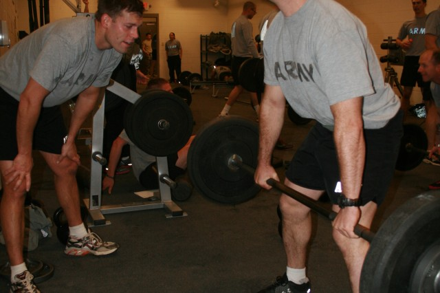 Staff Sgt. Ryan Chancellor (right), dead lifts 135 pounds as 1st Lt. Nick Dockery coaches, at Fort Carson, Colo. Chancellor, with 1st Battalion, 66th Armor Regiment, 1st Brigade Combat Team, 4th Infantry Division, and Dockery, with 2nd Bn., 12th Infantry Regiment, 4th BCT, 4th Inf. Div., participated in the Mountain Athlete Warrior workout as part of their training for the Best Ranger competition.