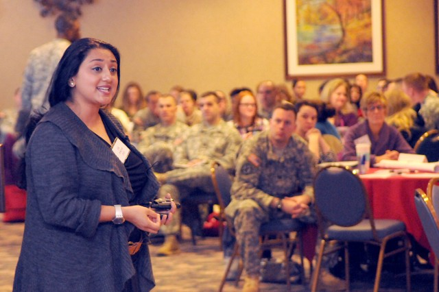 Dr. Amishi Jha, associate professor of psychology at the University of Miami, speaks to Soldiers, Family Members and civilian employees Tuesday during the Family Readiness Group Symposium at Fort Drum.