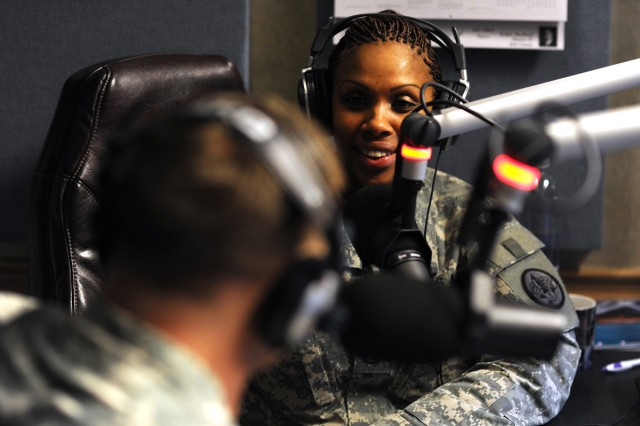 Fort Hood Radio broadcast journalist Staff Sgt. Julie Wallace-Myles conducts an interview inside the Fort Hood and III Corps Public Affairs Office's radio studio at Fort Hood, Texas. Wallace-Myles will host the FortHoodRadio.com's new morning show, which begins airing on the post's internet-based radio station at 9 a.m., Feb. 19, 2013. Besides being the voice of Fort Hood on the internet, FortHoodRadio.com has a partnership with 15 area commercial radio stations, who broadcast radio public service announcements and radio features produced by the staff.