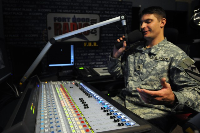 Staff Sgt. James Tapin, noncommissioned officer-in-charge of Fort Hood Radio, records a radio spot inside the Fort Hood and III Corps Public Affairs Office's radio studio at Fort Hood, Texas. Tapin, along with Staff Sgt. Julie Wallace-Myles, joined the public affairs effort to man the post's internet-based radio station in August.