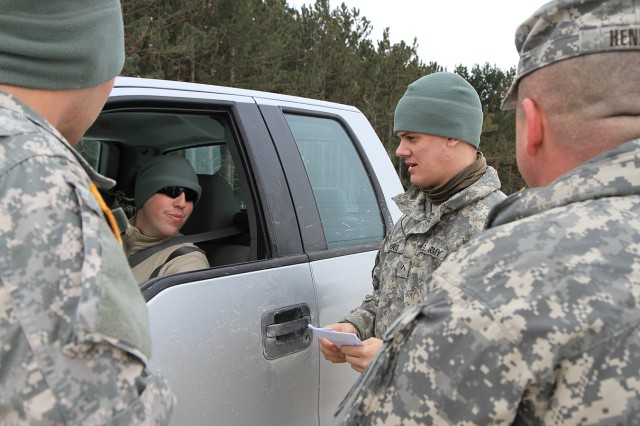 Pvt. Davis Harris, a military police officer assigned to Headquarters and Headquarters Company, 2nd Brigade Special Troops Battalion, 2nd Brigade Combat Team Rear, practices traffic stop procedures Feb. 7 during Guardian Academy on Fort Drum.