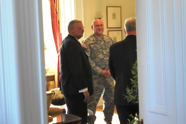 Brig. Gen. John Wharton, Army Sustainment Command commanding general and Rock Island Arsenal senior mission commander, talks with Rock Island Mayor Dennis Pauley during a meet-and-greet prior to a luncheon in Quarters 1 at RIA Feb. 13. (Photo by Jon Micheal Connor, ASC Public Affairs)