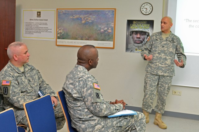 Col. Francisco Ruiz, Baumholder Dental Clinic commander, talks to community leaders about Soldier dental wellness during the clinic's first open house.