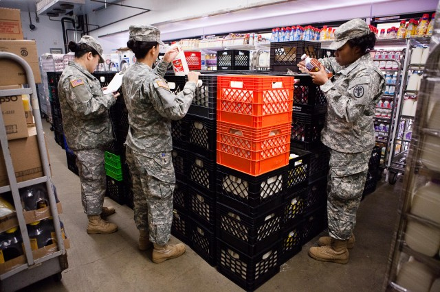 (From the left) Spc. Jun Wen, Spc. Keila Ortiz and Spc. LaTorie Lawrence, food inspectors with the Public Health Command, Fort Belvoir, Fort Myer Branch, inspect food at the Commissary on Joint Base Myer-Henderson Hall, Va., Feb. 13, 2013.