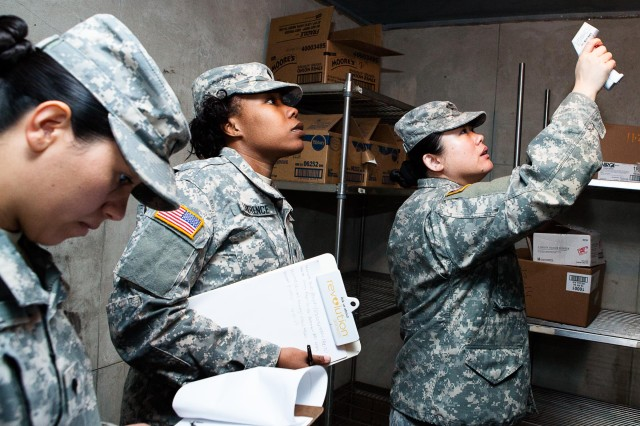 (From the left) Spc. Keila Ortiz, Spc. LaTorie Lawrence and Spc. Jun Wen, food inspectors with the Public Health Command, Fort Belvoir, Fort Myer Branch, take the temperature of a walk-in cooler in the dining facility on Joint Base Myer-Henderson Hall, Va., Feb. 13, 2013.