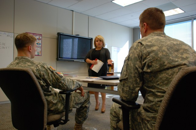 Two 470th Military Intelligence Brigade Soldiers learn Spanish from Patricia Lopez, an instructor contracted through the brigade's Command Language Program.