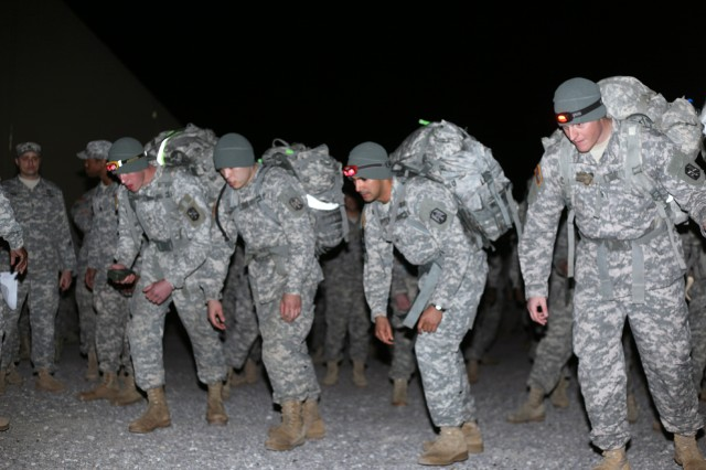 FORT SILL, Okla. -- A team of Soldiers begins the outdoor stations phase of the 214th Fires Brigade Leader Gut Check competition Feb. 7, 2013 at Contingency Operations Location Sanders here at about 7:50 p.m. Nineteen teams took off at 30-second intervals. Twelve miles and almost seven hours later the fastest team returned to win the competition.