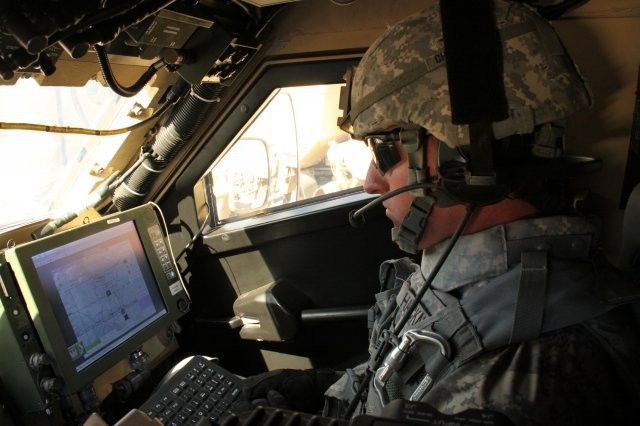 A Soldier with 2nd Brigade, 1st Armored Division, demonstrates Warfighter Information Network-Tactical Increment 2 and mission command on the move applications at the Network Integration Evaluation 12.1 in October 2011. The next two Network Integration Evaluations at White Sands Missile Range, N.M., will help validate Mission Command and Common Operating Environment software.