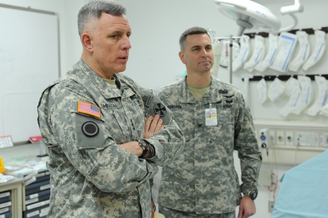 Eighth Army Commander Lt. Gen. John D. Johnson (left) and Col. Robert D. Forsten, commander of the Brian Allgood Army Community Hospital, tour the hospital at Yongan Garrison, South Korea, Feb. 14, 2013.