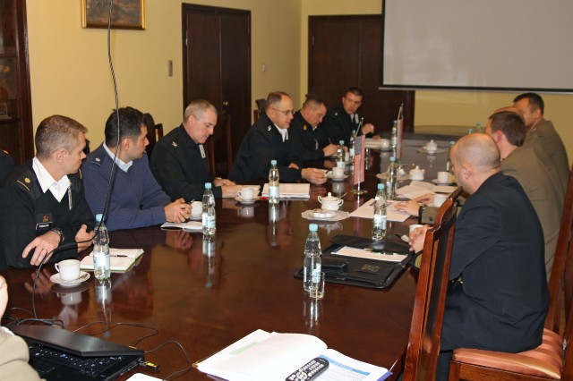 USASAC commander Maj. Gen. Del Turner, fourth from left, meets with representatives from the Polish military to discuss Foreign Military Sales cases for the country.
