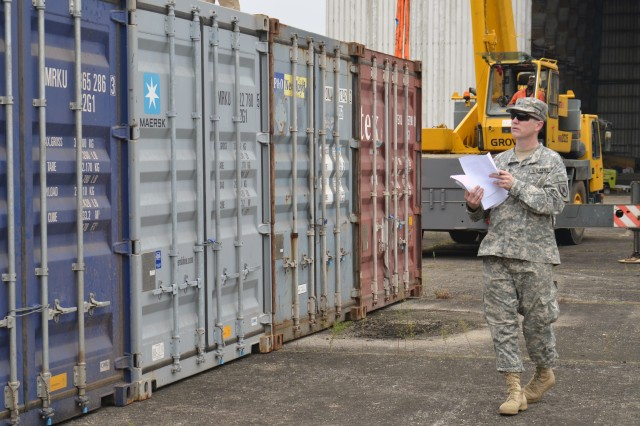 Sgt. Michael Bauder, equipment movement and control noncommissioned officer for Task Force Central, checks recently arrived storage containers with his paperwork at the Cameroon Air Force Base, Feb. 16, 2013, in Douala, Cameroon, Africa. Bauder, who serves with the North Dakota Army National Guard's 231st Brigade Support Battalion, is among the U.S. service members in Task Force Central preparing for the start of Central Accord 13, a combined-joint aerial resupply exercise and medical resupply and evacuation exercise. About 750 Cameroonian and American forces, along with observers from neighboring African countries, will take part in the exercise, which officially begins with an opening ceremony, Feb. 20.
