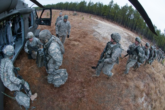 Airborne artillerymen with the 82nd Airborne Division's 1st Brigade Combat Team practice loading a UH60 Black Hawk helicopter during air assault training Feb. 8, 2013, at Fort Bragg, N.C.  The artillerymen are assigned to the 3rd Battalion, 319th Airborne Field Artillery Regiment.  (U.S. Army photo by Sgt. Michael J. MacLeod)