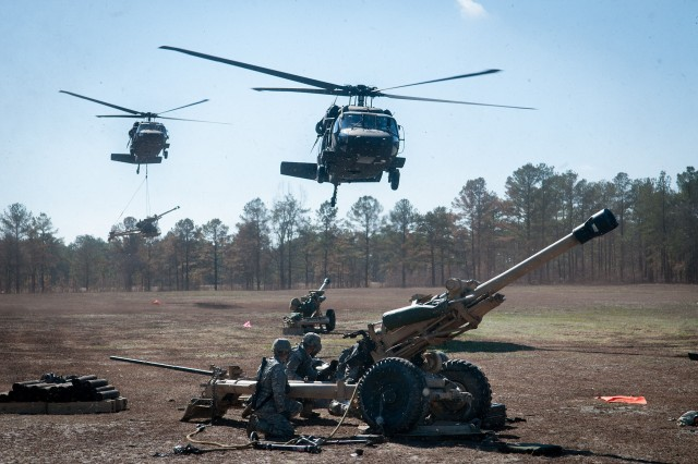 UH60 Black Hawk helicopters operated by soldiers with Company A, 1st Battalion, 169th Aviation Regiment, drop off artillerymen and their howitzers at a firing line during air assault training Feb. 8, 2013, at Fort Bragg, N.C.  The artillerymen are paratroopers with 3rd Battalion, 319th Airborne Field Artillery Regiment, part of the 82nd Airborne Division's 1st Brigade Combat Team.  (U.S. Army photo by Sgt. Michael J. MacLeod)