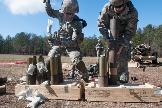 Paratroopers with the 82nd Airborne Division's 1st Brigade Combat Team prepare artillery shells for firing Feb. 8, 2013, at Fort Bragg, N.C.  The artillerymen transported their howitzers by helicopter, fired live rounds, and within a few hours, returned their guns to the original location by helicopter.  (U.S. Army photo by Sgt. Michael J. MacLeod)