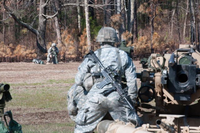 Artillerymen with the 82nd Airborne Division's 1st Brigade Combat Team prepare howitzers for firing during field training Feb. 8, 2013, at Fort Bragg, N.C.  The soldier in the distance is setting up an M2 aiming circle used for aiming and safety.  (U.S. Army photo by Sgt. Michael J. MacLeod)