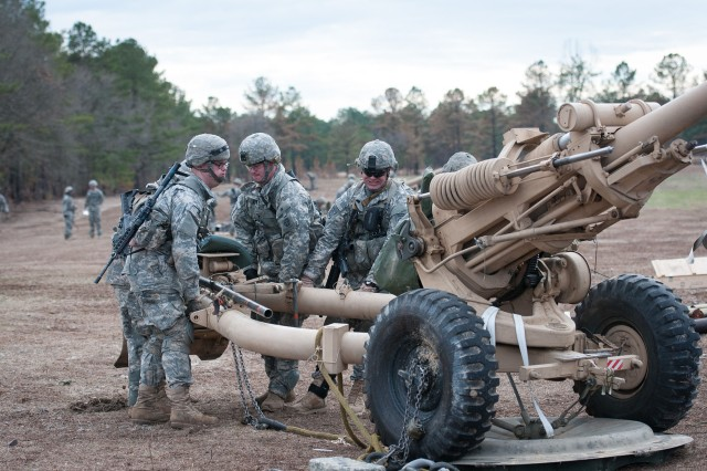 Artillerymen with the 82nd Airborne Division's 1st Brigade Combat Team pack up their M119A2 howitzer for transport by helicopter Feb. 8, 2013, at Fort Bragg, N.C.  The paratroopers are learning air assault skills.  (U.S. Army photo by Sgt. Michael J. MacLeod)
