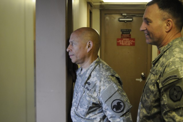Maj. Gen. Luis Visot, left, deputy commanding general for operations, U.S. Army Reserve Command, and Brig. Gen. I. Neal Black, commanding general, 364th Expeditionary Sustainment Command, check out the medical quarters on board the LCU 2025.