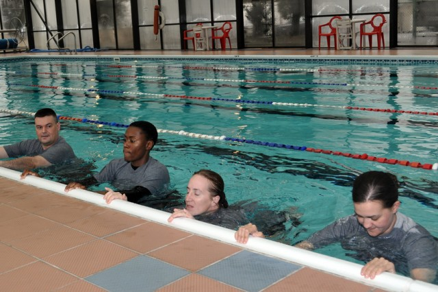 Staff Sgt. Glen D. Roussin, the Area II instructor trainer for the Pregnancy Postpartum Physical Training, leads the swimming session that is designed to maintain fitness and facilitate rapid recovery for pregnant service members, Jan. 25. (U.S Army photo by Pfc. Lim Hong Seo)